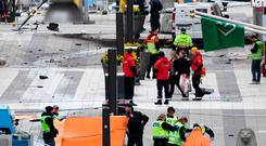 Emergency services work at the scene where a truck crashed into the Ahlens department store at in central Stockholm Photo: JONATHAN NACKSTRAND/AFP/Getty Images