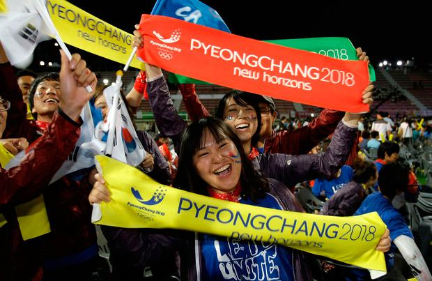 Locals in PyeongChang celebrate winning the 2018 Games in July 2011. Photo: Getty