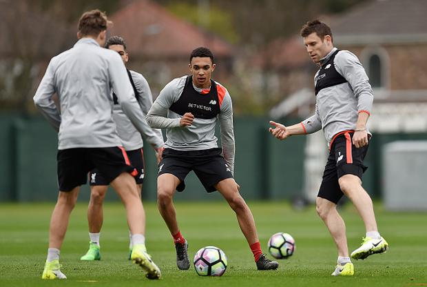 LIVERPOOL, ENGLAND - APRIL 03: (THE SUN OUT, THE SUN ON SUNDAY OUT) Trent Alexander-Arnold and James Milner of Liverpool during a training session at Melwood Training Ground on April 3, 2017 in Liverpool, England. (Photo by John Powell/Liverpool FC via Getty Images)