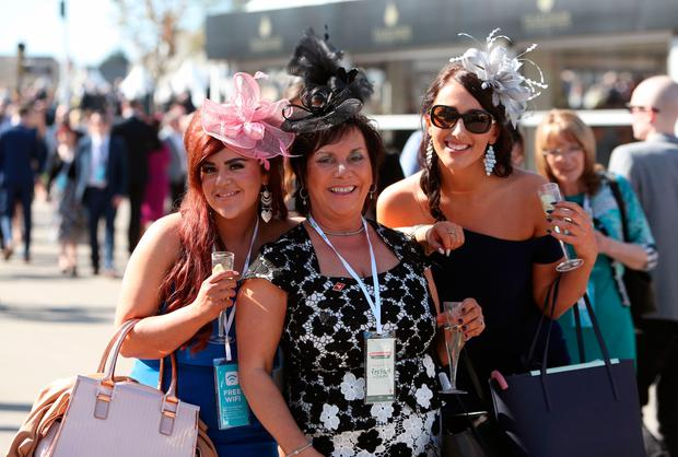 Female racegoers pose for a picture on Grand National Day of the Randox Health Grand National Festival at Aintree Racecourse. PRESS ASSOCIATION Photo. Picture date: Saturday April 8, 2017. See PA story RACING Aintree. Photo credit should read: David Davies/PA Wire