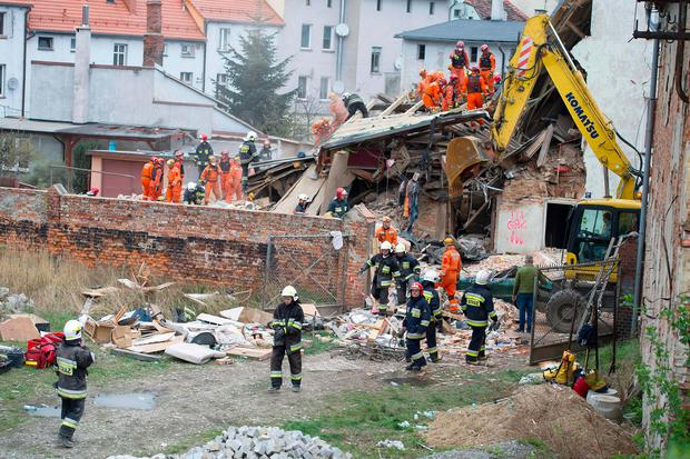 Rescuers search after a building collapsed burying several people in Swiebodzice, on April 8, 2017. / AFP PHOTO / NATALIA DOBRYSZYCKANATALIA DOBRYSZYCKA/AFP/Getty Images