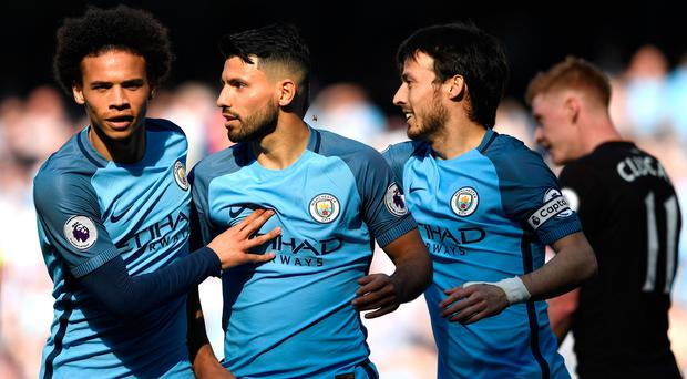 Sergio Aguero of Manchester City celebrates scoring his sides second goal with Leroy Sane and David Silva. (Photo by Stu Forster/Getty Images)
