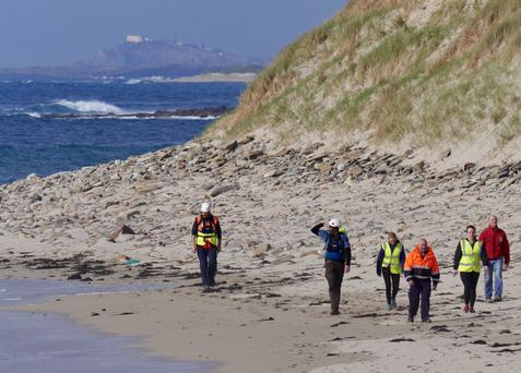 Volunteers searching at Elly Bay Atlantic Beach, about 6km north of Blacksod