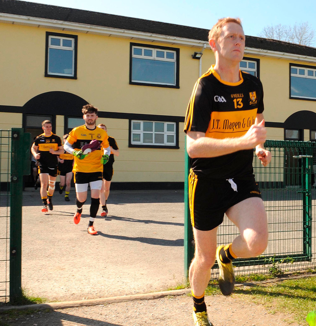 Colm Cooper runs on to the field in Killarney yesterday for his first game with Dr Crokes since announcing his retirement from inter-county football. Photo: Eamonn Keogh