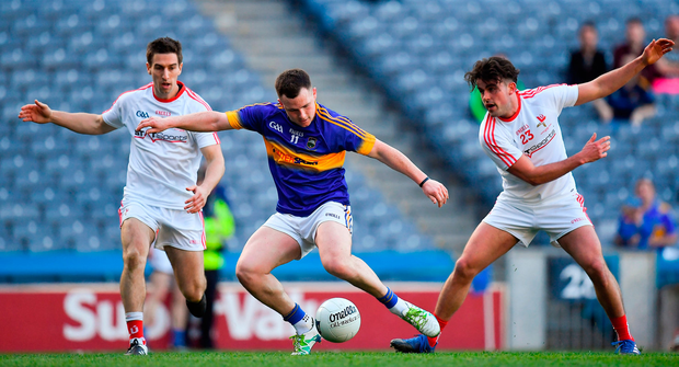 Tipperary's Kevin O'Halloran in action against Padraig Rath, left, and Kurt Murphy of Louth. Photo: Sportsfile