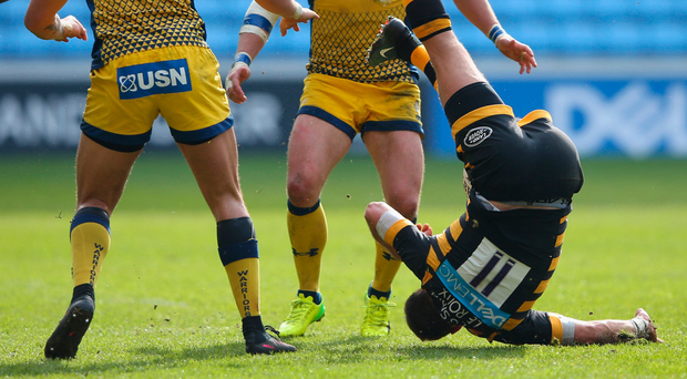 Willie Le Roux of Wasps comes crashing down after being tackled in the air by Worcester Warriors' Bryce Heem (number 14), who was subsequently sent off. Photo: Getty