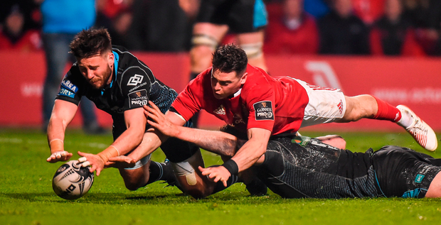 Ali Price, left, and Jonny Gray of Glasgow Warriors manage to ground the ball to prevent Ronan O'Mahony scoring a try. Photo: Sportsfile