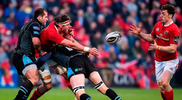Munster's Dave O'Callaghan is tackled by Fraser Brown and Rob Harley of Glasgow Warriors as he passes the ball to team-mate Darren Sweetnam. Photo: Sportsfile