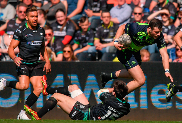 Leinster centre Robbie Henshaw is tackled by Sam Davies during the Guinness Pro12 match at the Liberty Stadium. Photo: Stephen McCarthy/Sportsfile
