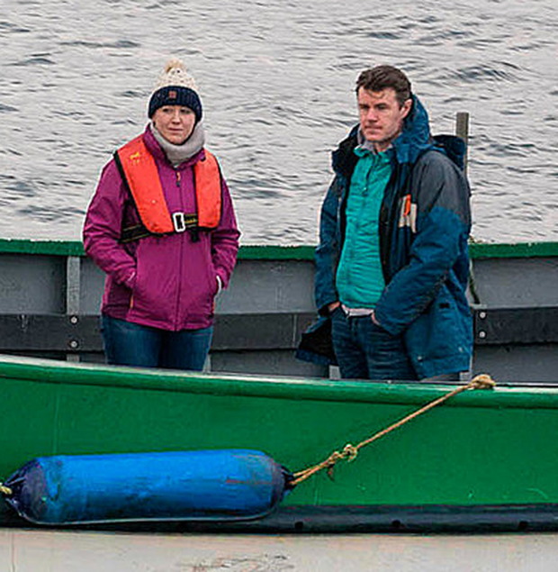 Sean and Orla Smith, whose brother Ciaran is missing, board a fishing boat to join the search at Ballyglass, Belmullet, Co Mayo Photo: Keith Heneghan / Phocus