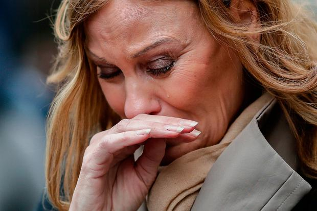 A woman weeps at the crash site yesterday Photo: AP Photo/Markus Schreiber