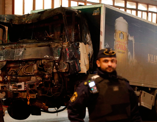 The damaged beer truck is towed away Photo: AP Photo/Markus Schreiber