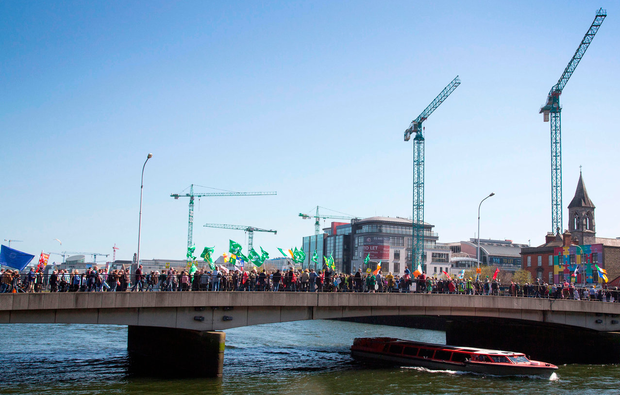 Protest: A march against water charges crosses the Matt Talbot Bridge in Dublin yesterday Photo: Colin O'Riordan