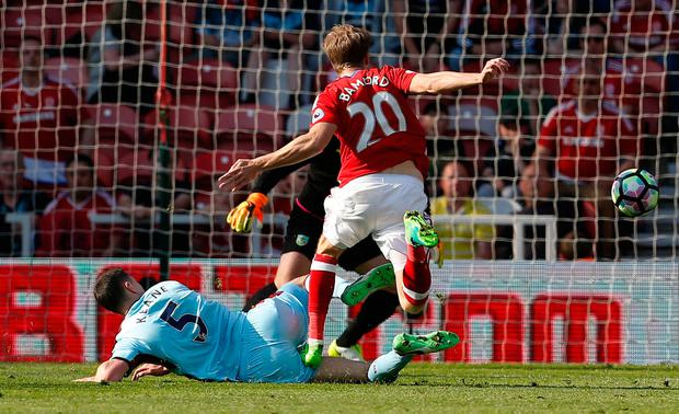 Burnley's Michael Keane fouls Middlesbrough's Patrick Bamford resulting in a yellow card. Photo: Reuters