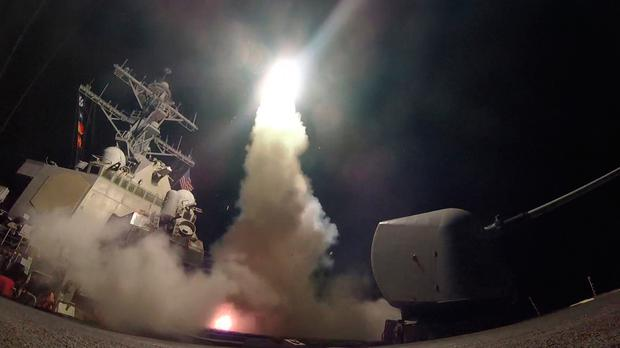 Undated handout photo issued by the US Navy of USS Porter (DDG 78) firing a tomahawk land attack missile from the Mediterranean Sea, as Britain backed the US missile strike on a Syrian air base as an