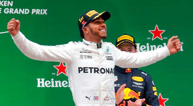Lewis Hamilton claimed his fifth win in Shanghai after leading every lap in the inclement conditions. Image: AP Photo/Andy Wong