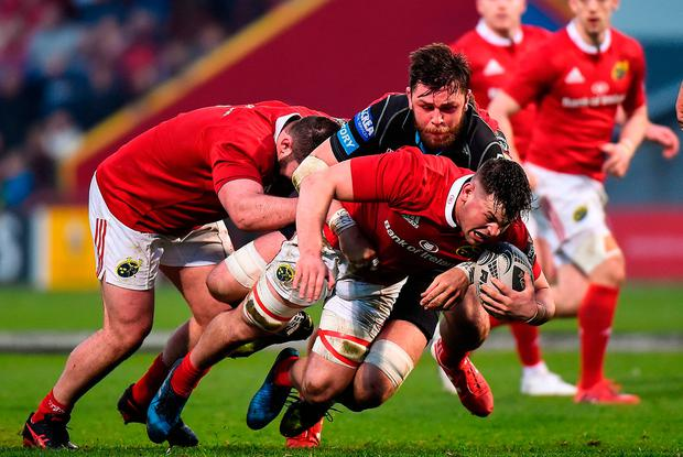 Conor Oliver is tackled by Ryan Wilson at Irish Independent Park. Photo by Matt Browne/Sportsfile