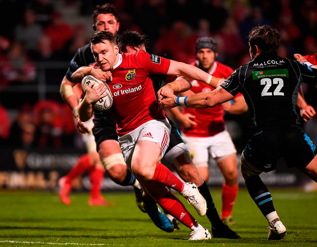 Rory Scannell of Munster is tackled by Ali Price and Peter Horne of Glasgow Warriors. Photo by Matt Browne/Sportsfile