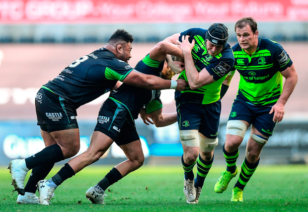 Ian Nagle of Leinster is tackled by Rhys Webb and Ma'afu Fia, left, of Ospreys. Photo by Stephen McCarthy/Sportsfile