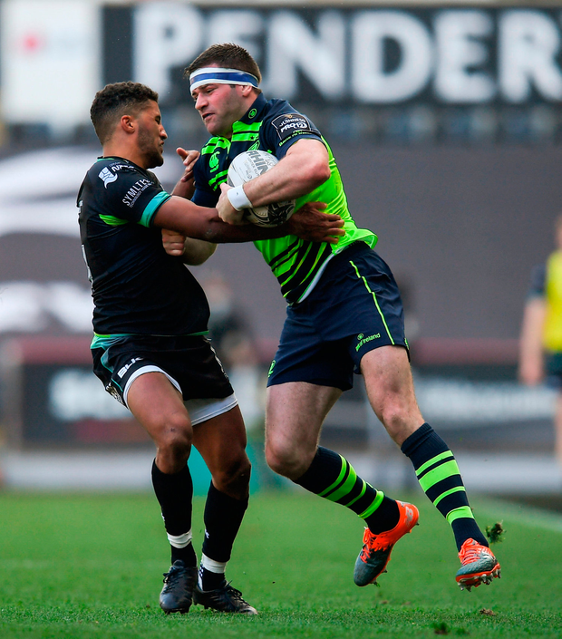 Fergus McFadden of Leinster is tackled by Keelan Giles of Ospreys. Photo by Stephen McCarthy/Sportsfile
