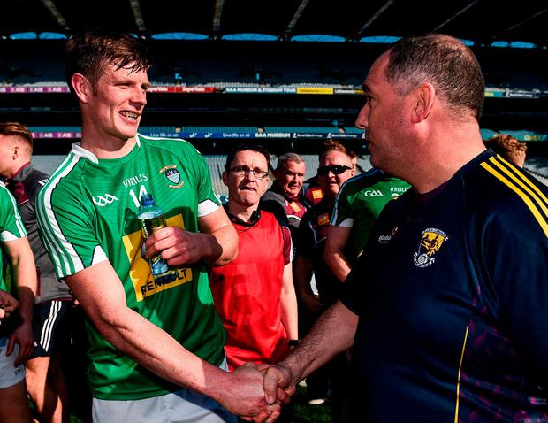 Wexford manager Séamus McEnaney congratulates John Heslin at the end of the game. Photo: Brendan Moran/Sportsfile