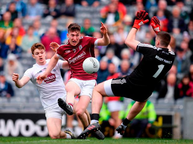 Galway's Johnny Heaney tries to find a way past Kildare goalkeeper Mark Donnellan. Photo: Stephen McCarthy/Sportsfile