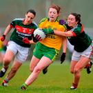 Donegal's Shannon McGroddy breaks through a challenge from Mayo's Doireann Hughes, right, and Martha Carter during the Lidl Ladies Football National League Division 1 refixture between Donegal and Mayo at St Mary's GAA Club, in Convoy, Co. Donegal. Photo: Sam Barnes/Sportsfile