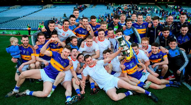 The Tipperary players celebrate with the cup. Photo: Ray McManus/Sportsfile