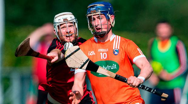 Armagh Captain David Carvill is closed down by Conor O'Prey. Photo: James McCann/Sportsfile