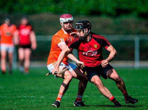 Andrew Bell looks for a way around Armagh's Danny Magee. Photo: James McCann/Sportsfile