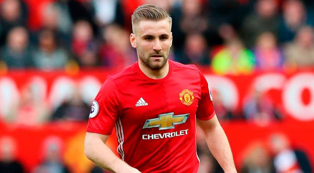 Luke Shaw contributed substantially to a win which heaps pressure on Arsenal ahead of the north London club's match at Crystal Palace tonight. Photo credit: Martin Rickett/PA Wire