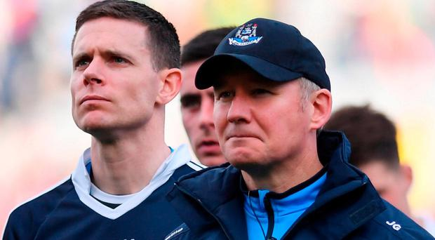 Dublin manager Jim Gavin and goalkeeper Stephen Cluxton watch the cup presentation following the Allianz Football League Division 1 Final match between Dublin and Kerry at Croke Park. Photo: Stephen McCarthy/Sportsfile