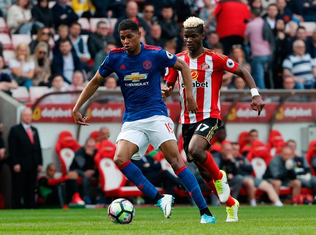 Manchester United's Marcus Rashford in action with Sunderland's Didier Ndong. Photo: Reuters / Russell Cheyne