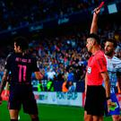 Neymar is shown the red card during Barcelona's defeat in Malaga. Photo by David Ramos/Getty Images
