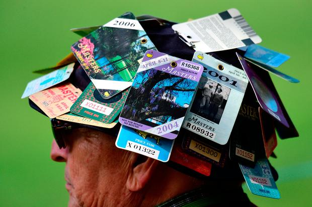 A regular patron displays his badges on his hat. Photo by Harry How/Getty Images