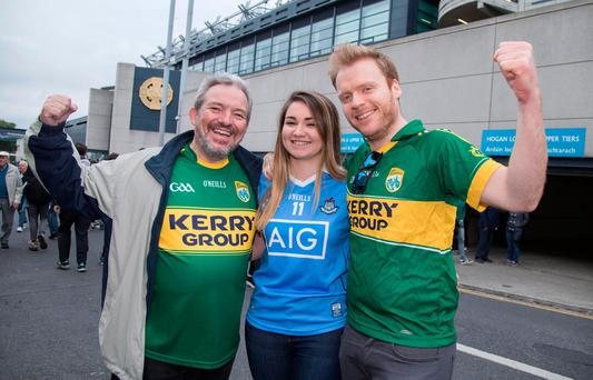 Kerry fans John Downey and John Fitzmorris with Dublin supporter Ailish O'Neill after the match Photo: Fergal Phillips