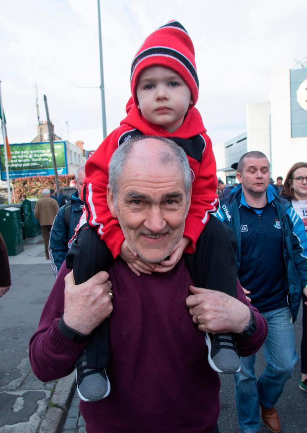 Tyrone manager Mickey Harte with his grandson Mickey Photo: Fergal Phillips