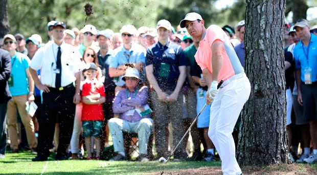 Rory McIlroy of Northern Ireland plays his second shot on the first hole as patrons look on during the final round of the 2017 Masters Tournament at Augusta National Golf Club on April 9, 2017 in Augusta, Georgia. (Photo by David Cannon/Getty Images)