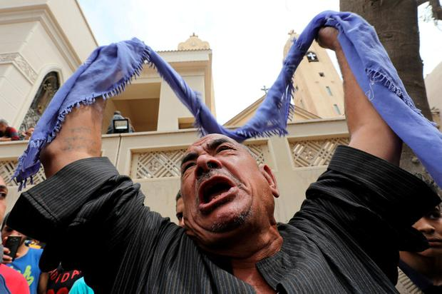 A relative of one of the victims reacts. Photo: Mohamed Abd El Ghany/Reuters