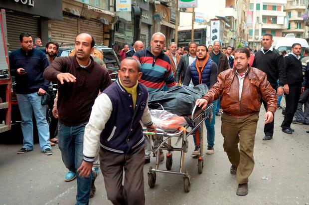 Egyptians wheel away a body. Photo: AFP/Getty Images