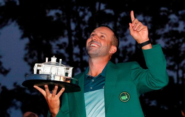 Sergio Garcia points to the sky as he holds the Masters trophy after winning at Augusta