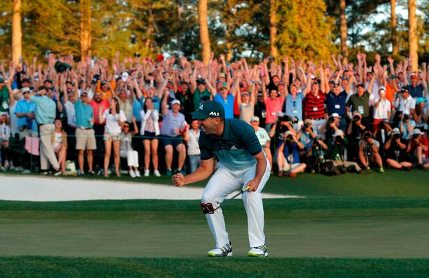 Sergio Garcia celebrates winning the Masters with a putt on the 18th green during a playoff against Justin Rose
