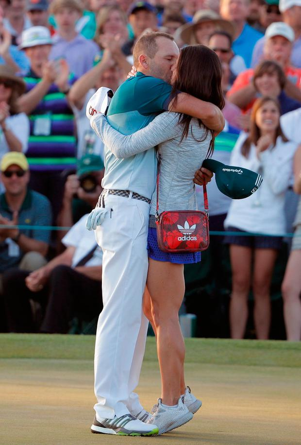 Sergio Garcia of Spain kisses his fiancée Angela Akins after he won the 2017 Masters golf tournament in a playoff against Justin Rose of England at Augusta National Golf Club in Augusta, Georgia, U.S., April 9, 2017. REUTERS/Lucy Nicholson