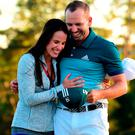 Sergio Garcia of Spain embraces fiancee Angela Akins in celebration after defeating Justin Rose on the first playoff hole during the final round of the 2017 Masters Tournament at Augusta National Golf Club on April 9, 2017 in Augusta, Georgia. (Photo by Harry How/Getty Images)