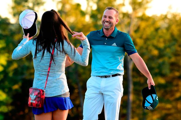 Sergio Garcia of Spain embraces fiancee Angela Akins in celebration after defeating Justin Rose (not pictured) of England on the first playoff hole during the final round of the 2017 Masters Tournament at Augusta National Golf Club on April 9, 2017 in Augusta, Georgia. (Photo by Harry How/Getty Images)