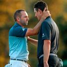 Justin Rose congratulates Sergio Garcia on the 18th green