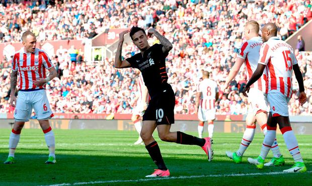Philippe Coutinho celebrates scoring his side's first goal during the Premier League match between Stoke City and Liverpool on Saturday