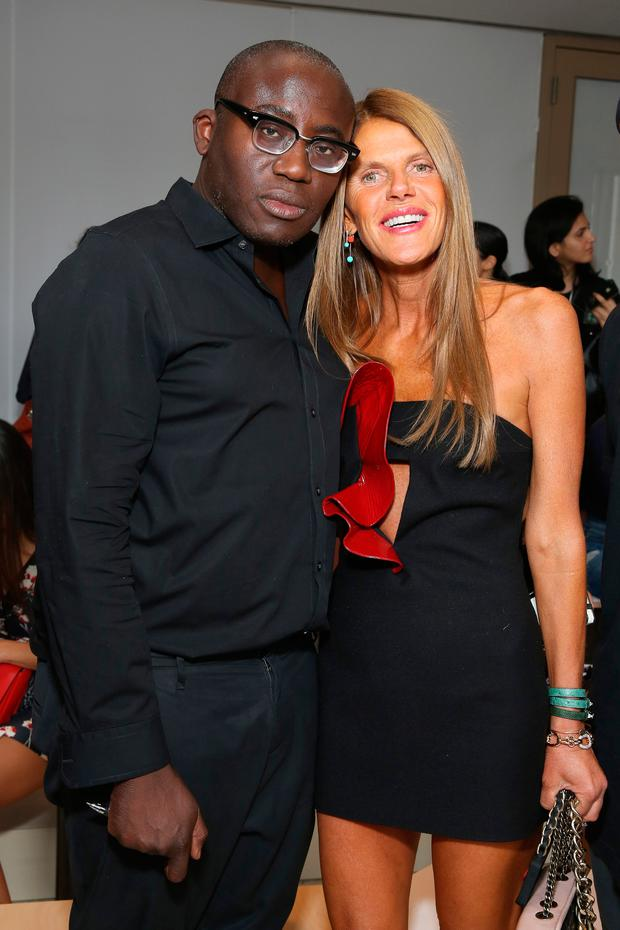 Edward Enninful (L) and Anna Dello Russo attend the Tory Burch fashion show during Mercedes-Benz Fashion Week Spring 2015 at Avery Fisher Hall at Lincoln Center for the Performing Arts on September 9, 2014 in New York City. (Photo by Cindy Ord/Getty Images for Tory Burch)