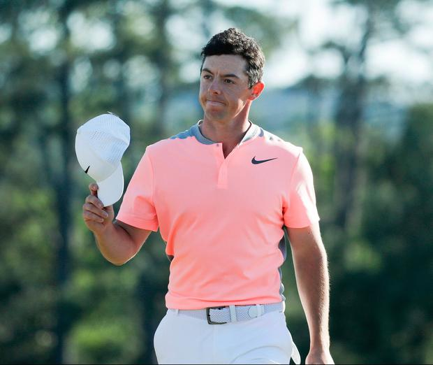 Rory McIlroy tips his hat on the 18th hole