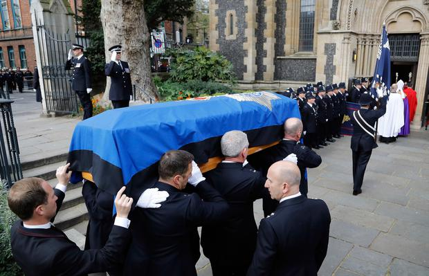 Pall bearers carry the coffin of Pc Keith Palmer into Southwark Cathedral in London